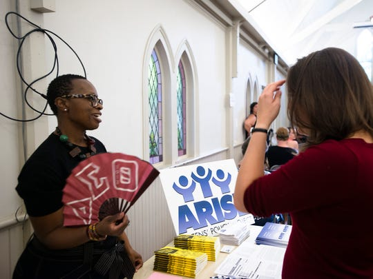 Shakira Jones talks to a fellow ARISE employee during a town hall meeting on Thursday, April 20, 2017, in Montgomery, Ala. About 50 people attended the event held to discuss legislative bill that representatives may be voting on.