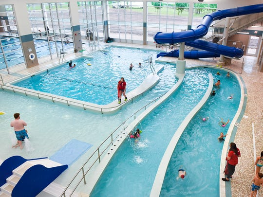 Families play in the pool at the new St. Cloud YMCA Community and Aquatic Center Tuesday, May 30, on opening day.