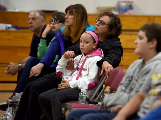 Emily Minichetti, 9 and her mother Gerri attend a presentation