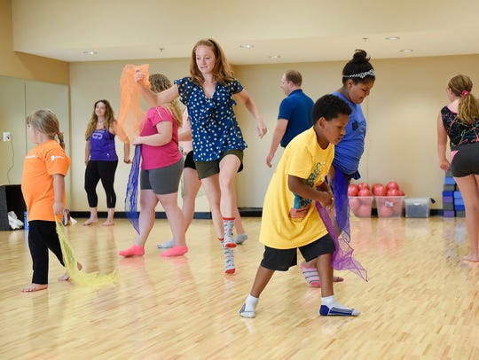 Children exercise using scarves and expressive dance