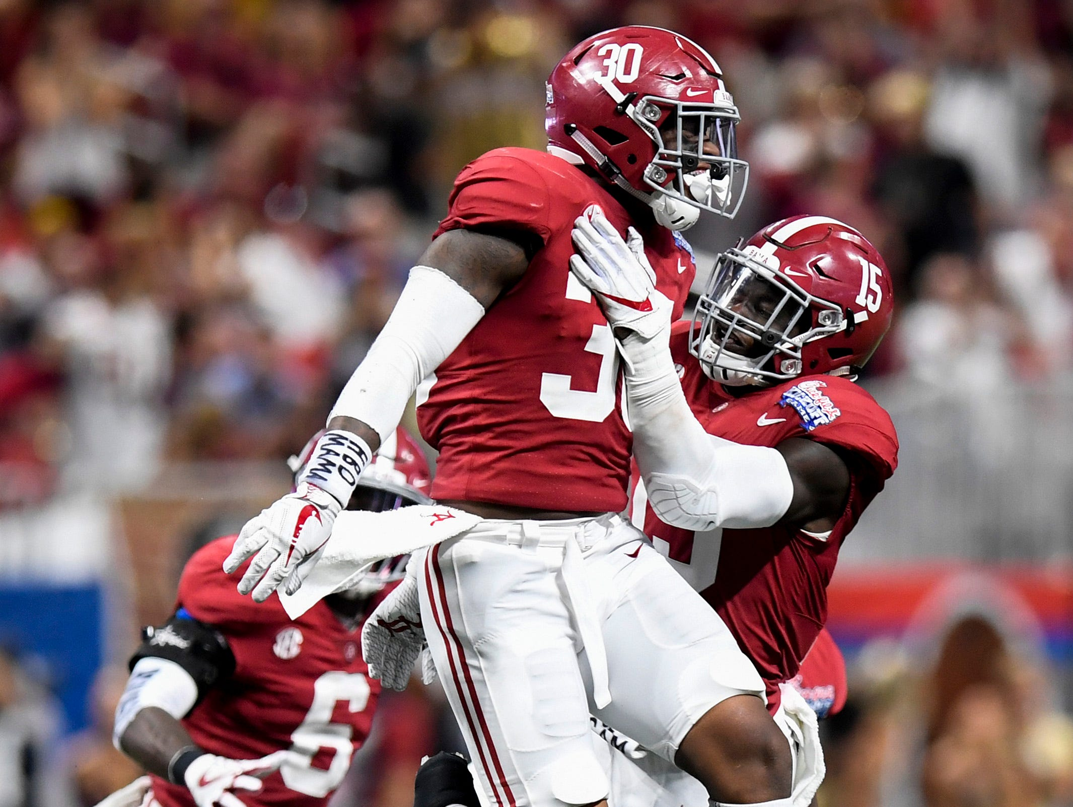 Alabama linebacker Mack Wilson (30) celebrates after intercepting a pass against Florida State in the Chick-fil-a Classic at the Mercedes - Benz Stadium in Atlanta, Ga., on Saturday September 2, 2017.