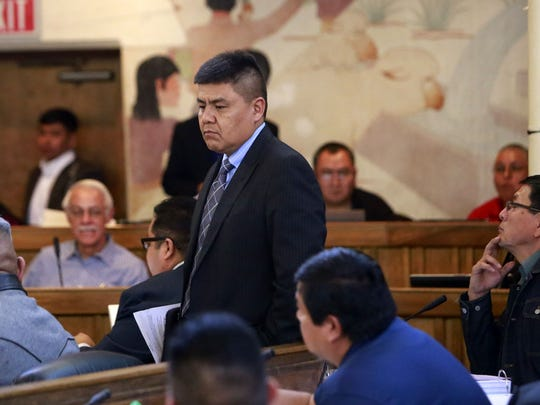Navajo Nation Council Delegate Jonathan Hale returns to his seat during the winter council on Jan. 26, 2016 in Window Rock, Ariz.