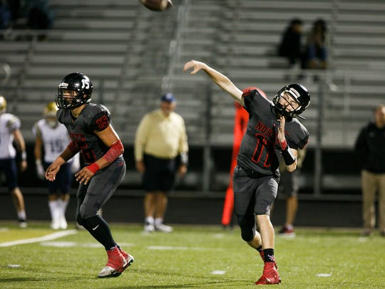 North Salem's Zac Sullivan (11) throws to a teammate