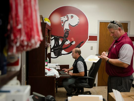 Prattville head coach Chad Anderson works in his office