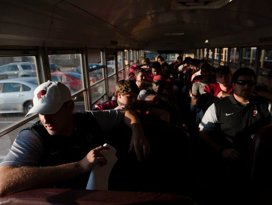 Prattville head coach Chad Anderson sits on the bus