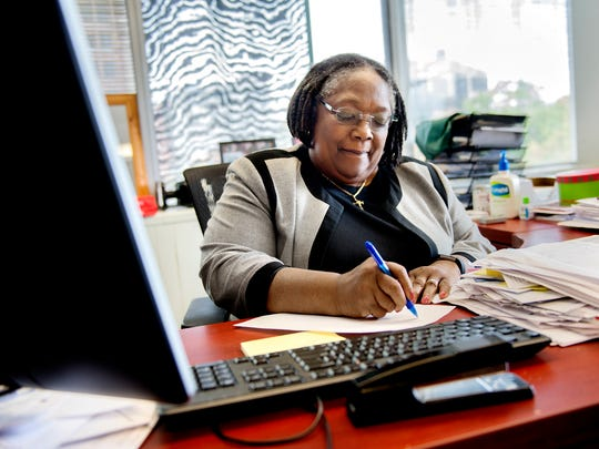 Joan Jackson Johnson, director of Human Relations and Community Services, works at her desk in her office on Tuesday, Sept. 19, 2017, at City Hall in Lansing.