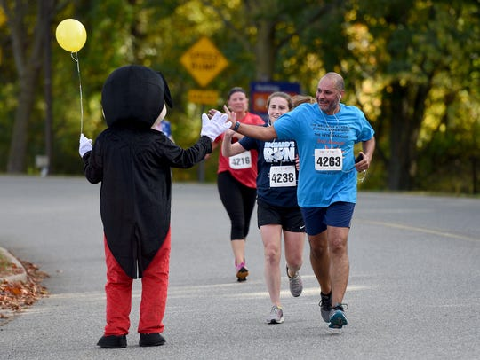 """Runners in the second annual """"Hero 5k Run/Walk,"""" at"""