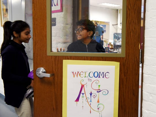 Classmates Redwana Uddin and Christopher Lopez, both 11, arrive for art class at School #24. Thursday's lesson focused on Surrealism in art, a philosophy the students will be incorporating into their artwork.