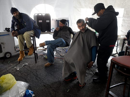 Melvin Camacho is given his first haircut in six months by Raheem McCoy. Camacho became homeless when he and his wife were kicked out of the an illegal apartment they were living in.