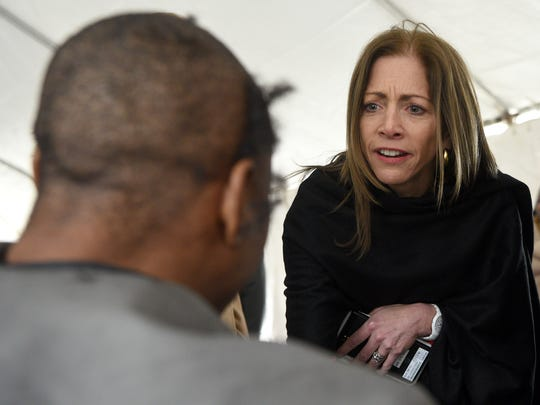 First Lady Tammy Murphy speaks with a homeless individual receiving a free haircut after participating in the Point-in-Time Count annual count of the homeless in Passaic County. The haircuts were donated by Raheem McCoy of Wave Kings in Paterson.