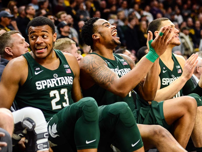 Michigan State Spartans forward Nick Ward (center)