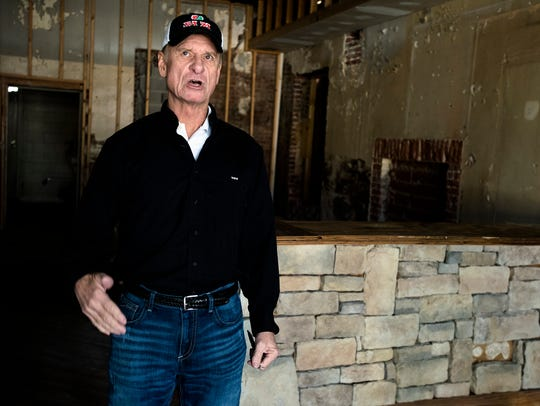 Mike Watson, property owner, stands inside a space