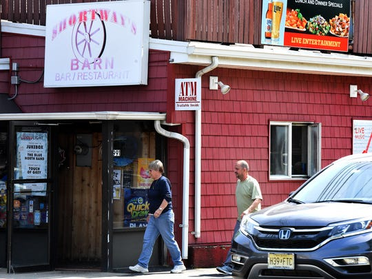 Dona Shortway O'Connell, manager of Shortway's Barn, walks in the restaurant with an employee on May 15.