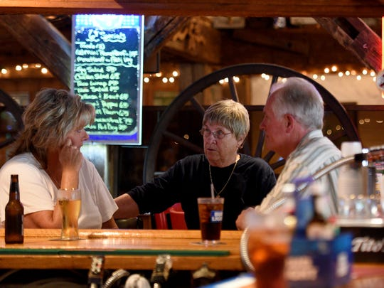 Dona Shortway O'Connell, center, manager of Shortway's Barn, catches up with her cousin, Laura Shortway Doud, and her husband, Jack, of Wayne, who met at the restaurant.
