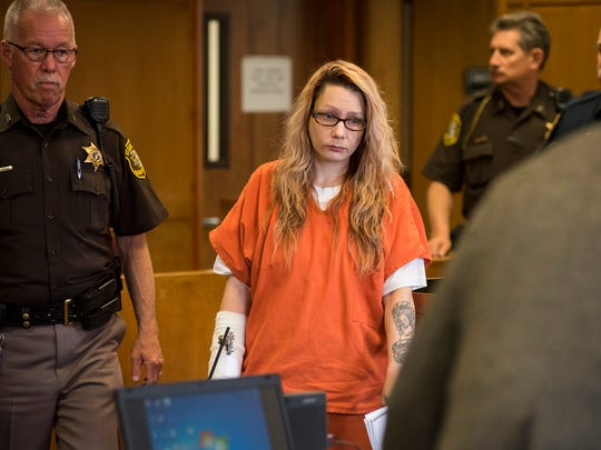 Theresa Marie Gafken is led to the defendant's table in Judge John Monaghan's courtroom before her motion hearing Tuesday, May 22, 2018. Gafken, 35, of Port Huron, is being charged with second-degree murder for the April 11 car crash that killed a 48-year-old Chesterfield woman.