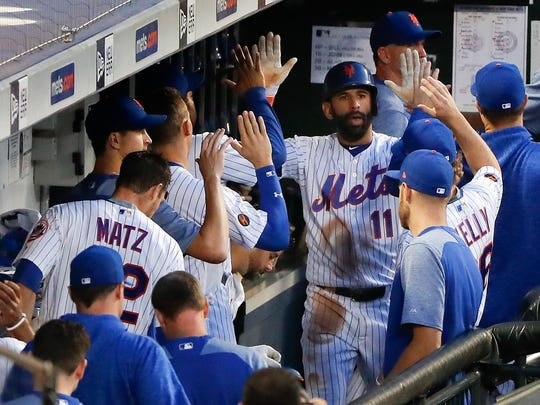 New York Mets' Jose Bautista (11) is congratulated by teammates after hitting a solo home run against the Washington Nationals during the fourth inning of a baseball game Thursday, July 12, 2018, in New York.