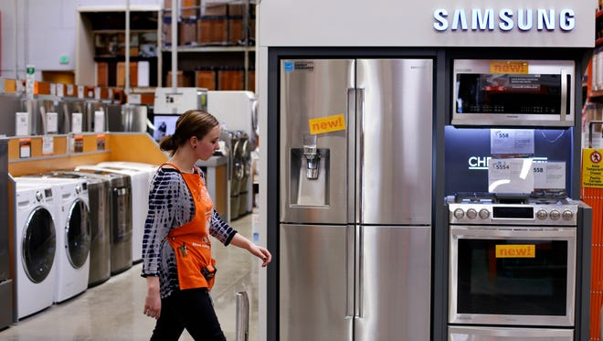 An employee walks past a display of appliances at a Home Depot in Robinson Township, Pa.