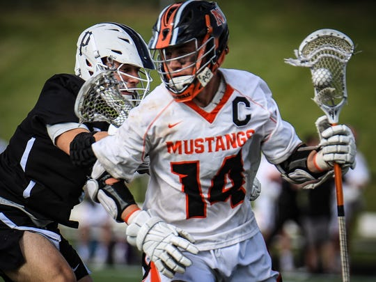 Carrying the ball for Northville is Anthony Salamone,