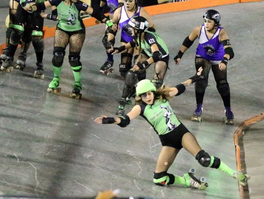 A jammer for Las Viudas Negras looses her balance after