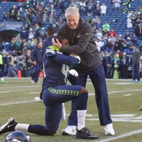 SEATTLE, WA - DECEMBER 14:  Defensive back Byron Maxwell #41 of the Seattle Seahawks gets a hug from head coach Pete Carroll prior to the game against the San Francisco 49ers at CenturyLink Field on December 14, 2014 in Seattle, Washington.  (Photo by Otto Greule Jr/Getty Images)