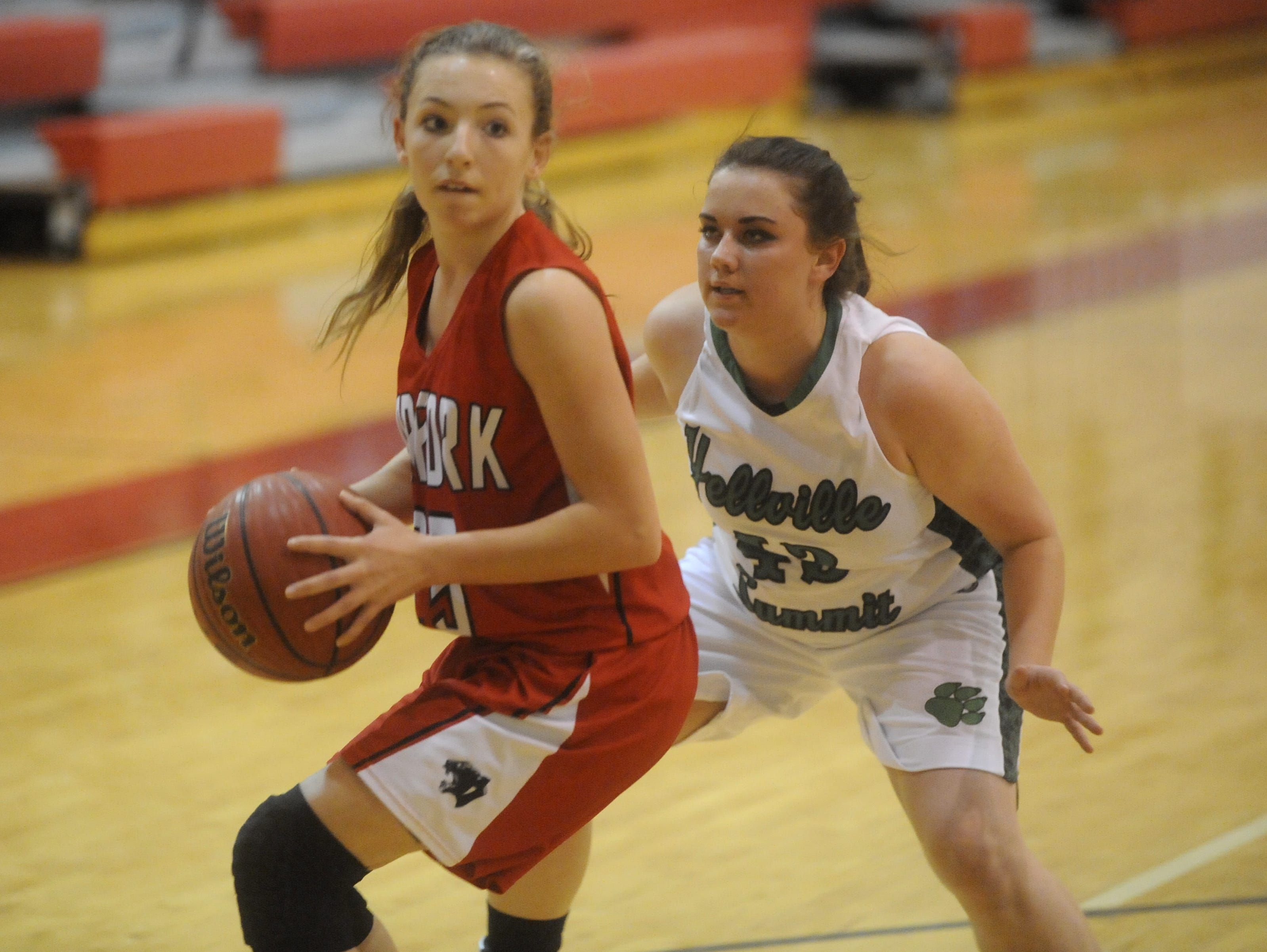 Norfork's Ivy McGowan is defended by Yellville-Summit's Kira Gentry-Cape.