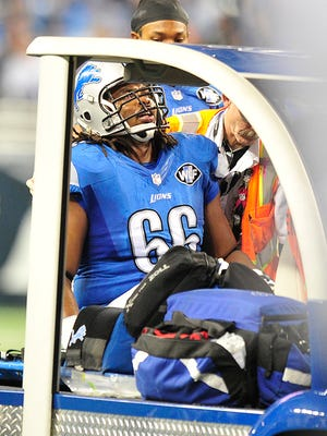 LaAdrian Waddle is taken off the field on a cart Sunday against the Vikings.