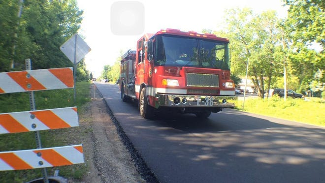 A Neenah-Menasha Fire Rescue rig leaves the scene of a fire in the 3000 block of Chain Drive.