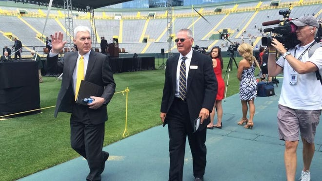 Green Bay Packers general manager Ted Thompson waves to shareholders after speaking at the team's annual meeting at Lambeau Field.