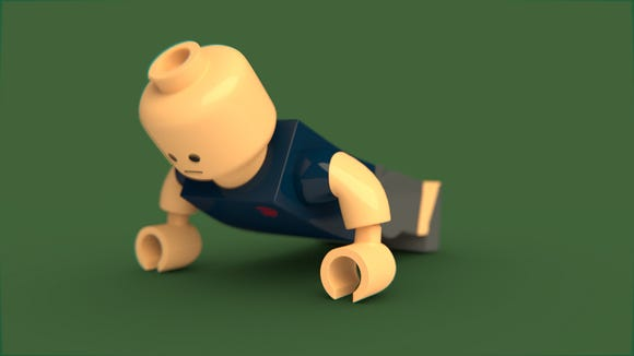 A Lego man doing a push-up.