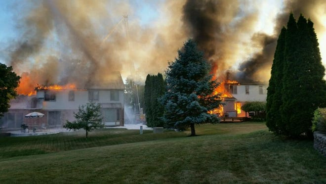 A fire state started in the garage of a Sullivan Lane home in Novi spread to the rest of the house and a home next door on Saturday.
