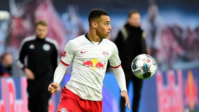 From Dec. 21, 2019, Leipzig's Tyler Adams controls the ball during the German Bundesliga soccer match between RB Leipzig and FC Augsburg in Leipzig, Germany.