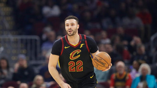 """Cleveland Cavaliers' Larry Nance Jr. drives against the Atlanta Hawks in the first half of an NBA basketball game in Cleveland. Nance Jr. couldn't wait to get back on the floor. After being cooped up for nearly two months because of the COVID-19 pandemic, the Cavaliers forward was grateful to work out at the team's facility last week. """"This is the longest I haven't played a game of basketball in my entire life,"""" he said Tuesday, May 12, 2020 on a Zoom conference call."""