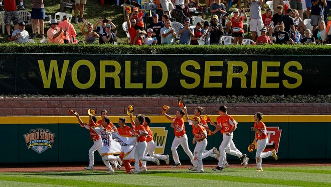 From Aug. 25, 2019, River Ridge, Louisiana, takes a victory lap around the field at Lamade Stadium after winning the Little League World Series Championship game against Curacao, 8-0, in South Williamsport, Pa. The 2020 Little League World Series and the championship tournaments in six other Little League divisions have been canceled because of the new coronavirus pandemic.
