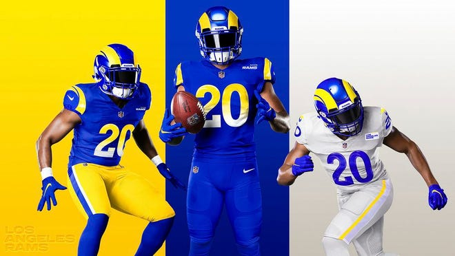This undated graphic image released by the Los Angeles Rams NFL football team shows a composite of their new uniforms - two versions of 'royal,' from left, and 'bone' at right. The Rams have unveiled new uniforms ahead of their move into SoFi Stadium this year.