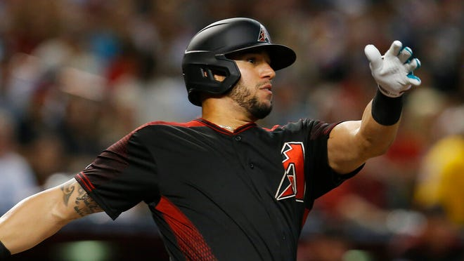 Arizona Diamondbacks' David Peralta hits against the San Francisco Giants in the first inning of a baseball game in Phoenix. The Diamondbacks have finalized a $22 million, three-year contract with Peralta that runs through 2022, Monday, Jan. 13, 2020.