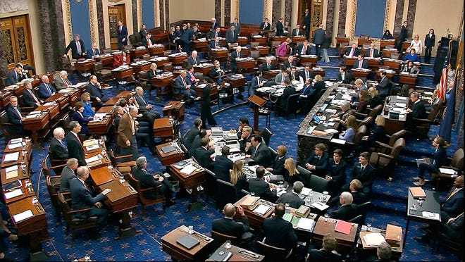 In this image from video, Senators cast their vote on the motion to allow additional witnesses and evidence to be allowed in the impeachment trial against President Donald Trump in the Senate at the U.S. Capitol in Washington on Friday.
