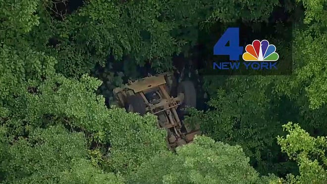 In this June 6, 2019 file photo taken from video provided by NBC New York, a light medium tactical vehicle sits overturned near the Camp Natural Bridge summer military training camp off Route 293.