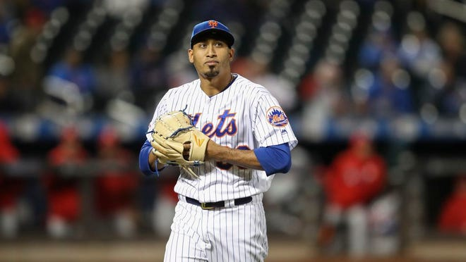 New York Mets relief pitcher Edwin Diaz walks off the field during the ninth inning of a baseball game against the Philadelphia Phillies, Friday, Sept. 6, 2019, in New York.