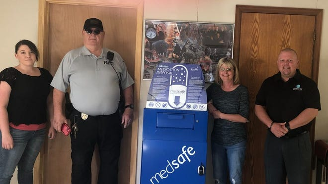 From left to right Court Clerk Cassie Tibbs, Assistant Police Chief Bill Ware, Mayor Lacosta Rawls, and SPF PFS Coordinator David Holland in front of the Earlsboro medication drop box at the Earlsboro Police Department.