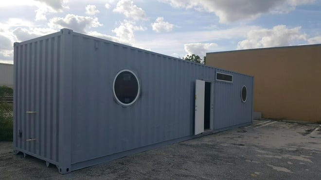 Once it's finished and painted, this container is headed for the Bahamas, to house a family that lost its home to Hurricane Dorian.