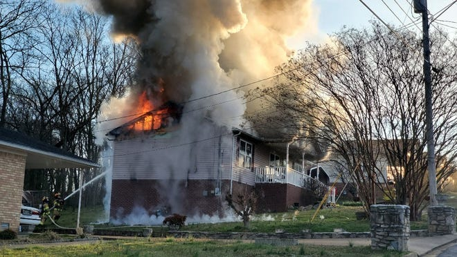 A fire engulfs a residential home on Skyline Drive on Sunday in Columbia. According to emergency crews, one person was declared deceased at the scene.