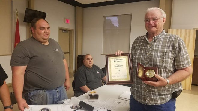 The Bath Volunteer Fire Department Inc. recently presented an award and certificate to Doug Bigelow for 50 years of service to the department.