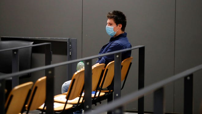 Portuguese hacker Rui Pinto sits in the courtroom at the start of his trial in Lisbon, Friday, Sept. 4, 2020. Lisbon court is hearing the case against 31-year-old Pinto, whose expose was published over financial revelations about European soccer players, top clubs, influential agents and continental officials.