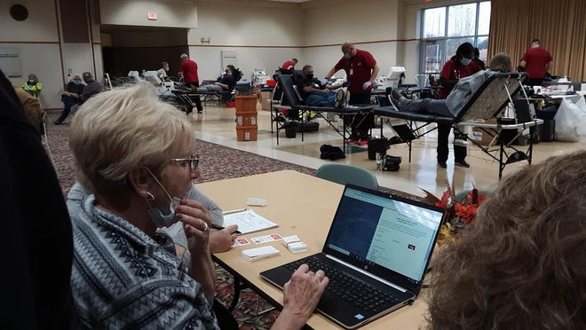 Volunteer Ag Johanneck scheduled donors for next January's blood drive in the Redwood Area Community Center, while the Mankato-based Red Cross took donations Oct. 19.