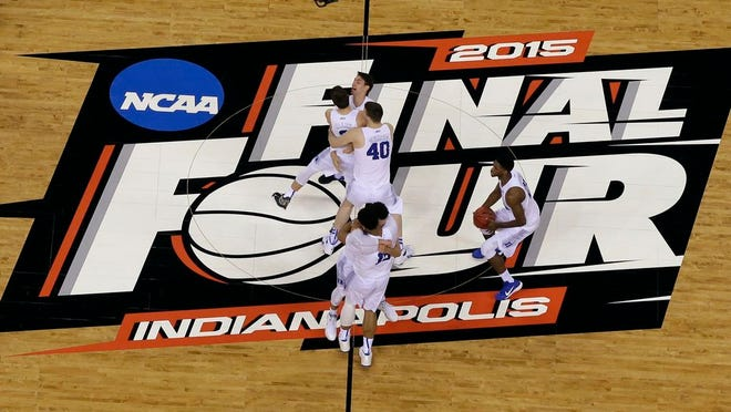 Duke players celebrate after the NCAA Final Four college basketball tournament championship game against Wisconsin in Indianapolis, in this Monday, April 6, 2015, file photo.