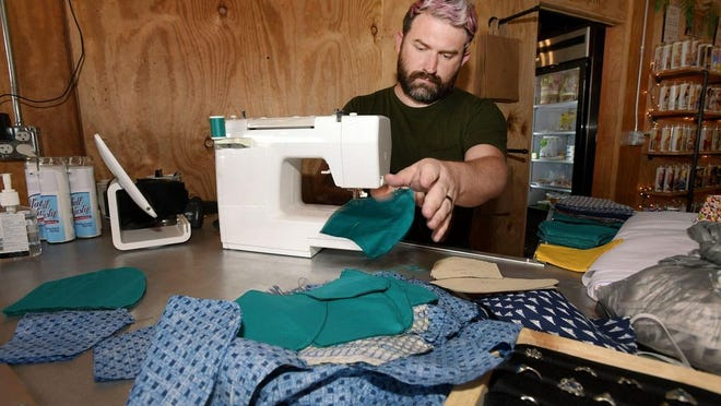 promote their local support. Bobby Kelley, who owns Bobby K boutique in Jacksonville, Florida, is one of the thousands of small business owners forced to pivot his business model because of the pandemic. Bob Self/Florida Times-Union