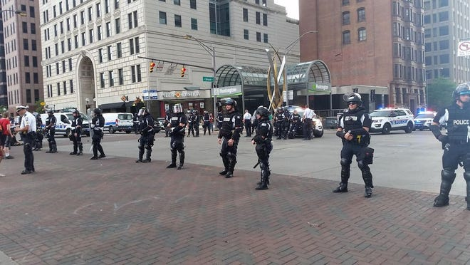 Columbus police in riot gear were standing guard at the intersection of Broad and High streets late Sunday afternoon.