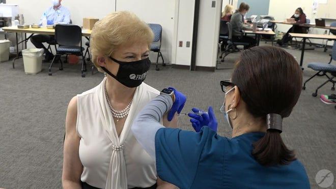 Paula Baker receiving the vaccine.