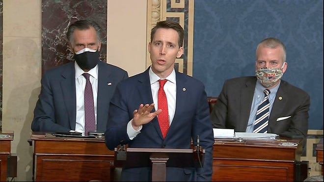FILE - In this Jan. 6, 2021 file image from video, Sen. Josh Hawley, R-Mo., speaks at the U.S. Capitol in Washington. At least four additional companies that have donated to Hawley have announced they are suspending campaign contributions. The announcements by Cerner Corp. in Kansas City, Ameren Corp. and Edward Jones in St. Louis and the Chicago law firm Bryan Cave Leighton Paisner adds to a growing list of donors who have cut ties to the Missouri Republican senator since the attack on the Capitol last week.