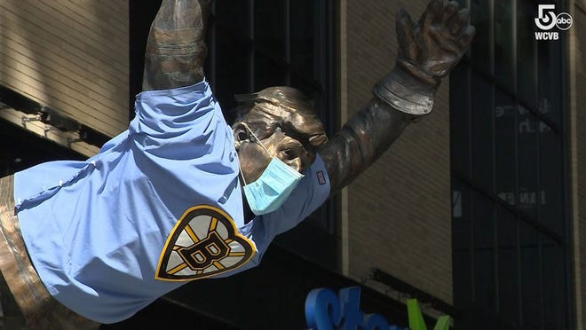 The Bobby Orr statue at the Garden is paying attention to the COVID-19 safety guidelines.
